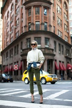 Blair Eadie // red lips, big sunglasses, cable knit sweater, denim jacket, green pants and pumps