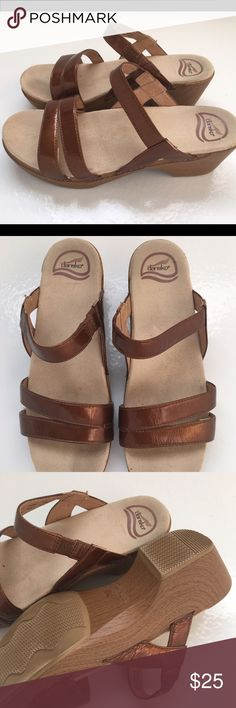 Women's Dansko Patent Leather Sandals sz 41 Super comfortable and cute ladies Dansko sandals. These are a patent leather in bronze color with sueded soles. Perfect condition! Dansko Shoes Sandals