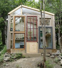 You have gotta check out these diy greenhouses, build from old windows, reclaimed door and a little magic..... This diy greenhouse...