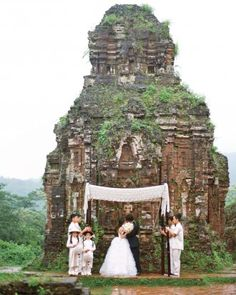 The couple trimmed their guest count down - way down - from 300 to the two of them. The intimate ceremony was held amid 4th-century temple ruins in Vietnam. View more pictures from this wedding online!