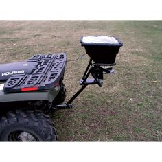 Product Spotlight: this 12 Volt Field Tuff ATV Hitch-Mount Spreader is easy to use, mounting directly to an ATV or UTV's 1 or receiver. Heavy-duty poly hopper holds 8 gallons of grass seed, fertilizer and small grains. Landscaping Equipment, Landscaping Tools, Atv Implements, Atv Attachments, Hidden Gun Storage, Atv Trailers, Tractor Loader, Amphibious Vehicle, Atv Riding