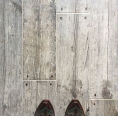 Tile that looks like weathered barn wood... LOVE!  My fav update I've done to the house yet!