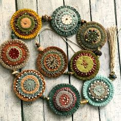 Very cool, could do moon cycle or chakra chains! Very cool, could do moon cycle or chakra chains!nice addition with seed beeds penny rugCould do as mantel garland Wool Applique Patterns, Felt Applique, Textile Jewelry, Fabric Jewelry, Felt Crafts, Fabric Crafts, Crochet Diy, Wool Embroidery, Penny Rugs