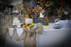 burlap garland and sunflower bouquets