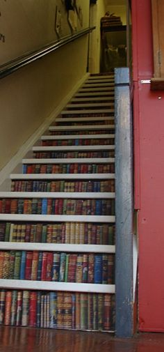 Would be even more awesome if they were actually book shelves but...Steps Risers with ... WALLPAPER BORDERS applied to them.