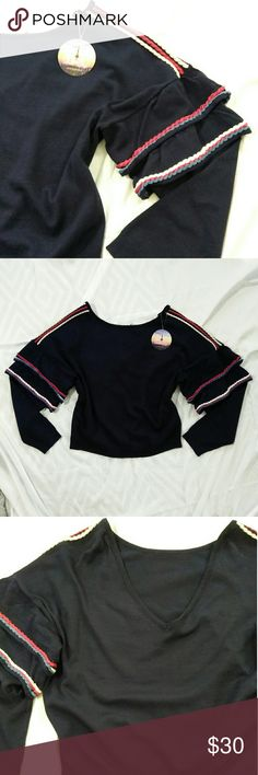 Love by Design Navy Ruffle Sleeve Cropped Sweater Adorable nautical style cropped sweater with ruffle sleeves and red and white trim. Back has low v back. Could possibly be worn either way. Reminds me of something you might see on Brandy Melville. Sweaters