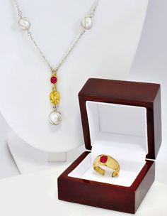 A powerful gemstone talisman. Two 2ct, unheated flawless rubies, a 6ct flawless, unheated yellow sapphire and three large round Chinese tissue nucleated pearls.
