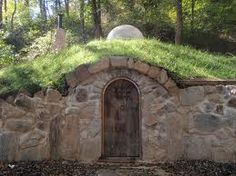 Rear entrance, would not be large rock, but rather straw bale construction wall with the stone arch way and door