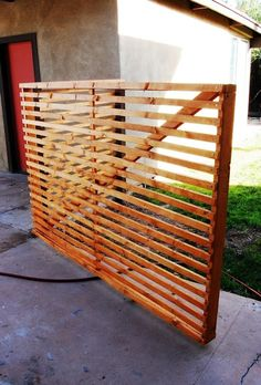 diy fence made from SLATS super cool and allows for great air flow. maybe do this on the vertical?