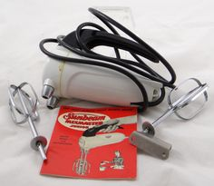 This is a vintage, and in the original box, Sunbeam mixer. It works and everything! People from that era must have been strong because everything was heavy and made of metal. Plenty more at http://stores.ebay.com/Gully-Farm-Consignment?_rdc=1