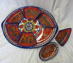 I absolutely love this Ceressa antipasto platter with removable dishes.  The one I have is less red and doesn't come apart- works great for a seder plate- but I could find a place for this one!