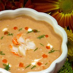 Lobster Bisque. Serve with crusty bread and a crisp light wine, such as a riesling or pinot grigio.