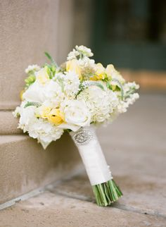 white and yellow bouquet of hydrangea, tulips and roses by Daffodil Parker