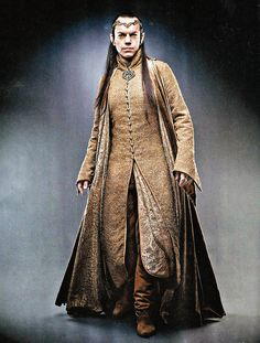 Hugo Weaving as Elrond in the Hobbit. Elves have costumes that emphasize vertically. It looks like he's wearing at least three layers. Also, there's something distinctly Chinese about Elven costumes in the LotR and Hobbit Movies.