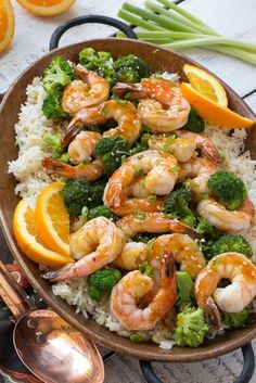 This orange shrimp and broccoli with garlic sesame fried rice is the perfect quick and easy meal for a busy weeknight or for entertaining guests. Ad Orange Shrimp and Broccoli Quentin Mirabal Food This orange shrimp and broccoli wit Scampi, Seafood Recipes, Dinner Recipes, Cooking Recipes, Orange Shrimp Recipes, Chicken Recipes, Brocolli Recipes, Brocolli Salad, Cookies Banane