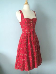 A cuter than cute (the print of is of folk costume wearing men and women) 1940s/50s dirndl inspired dress. *Love!* #red #vintage #1940s #1950s #dirndl #dress #folk #costume #German #clothing