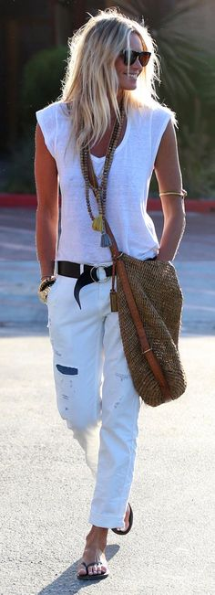 Casual white outfit styled with a leather belt, largo boho crossbody bag, and layered beaded and tassel necklaces