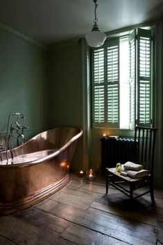 A copper clawfoot tub paired with a soothing shade of muted green calls for pure perfection.