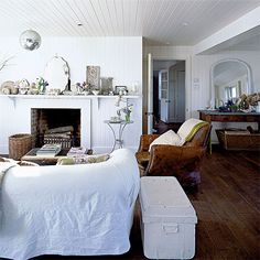 White sofa, tan leather chair, dark wood floors, crisp white walls. Love this combination of dark and light!!
