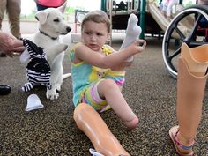Toddler without feet gets puppy without a paw