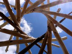 """""""A reciprocal roof is a self-supporting, round structure composed of interlocking beams that equally bear the weight of one another."""""""