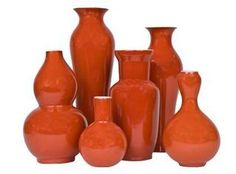 The shapes and sizes of these orange vases create a nice look on a shelf or table. #orange  #vase
