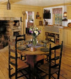 Primitive kitchen ~ love the mustard cabinets & worn wood floor.