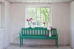 This room in this photo is beautiful!  I love how the bench and flowers stand out against the white walls! The combination feels very natural, and really draws your attention to the bench. I think it would be great to design a room like this one in my future home!