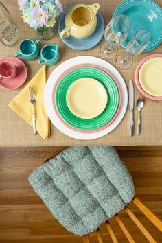 Casual Spring Pastel Table Setting featuring our Brisbane Sea Glass Aqua Dining Chair Cushion with Ties. This tweed fabric is woven with aqua, tea, green, seafoam green, and white making it the idea match for your coastal beach house decor or your cool breeze modern aqua kitchen.  Our chair pads are made in the USA by Barnett Home Decor and latex foam filled so they will not go flat. Teal Dining Chairs, Dining Chair Cushions, Aqua Kitchen, Tweed Fabric, Pacific Blue, Beach House Decor, Outdoor Fabric, Sea Foam, Fabric Decor
