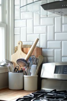 Arizona Tile beveled subway tile in herringbone pattern. Gout from a Home Depot in platinum