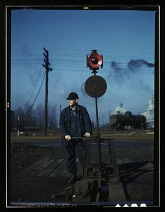 Daniel Senise throwing a switch while at work in an Indiana Harbor Belt Line railroad yard. February 1943. Jack Delano.