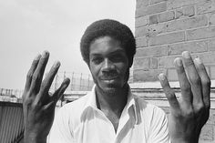 MICHAEL HOLDING THE WEST INDIES CRICKET TEAM FAST BOWLER HOLDS UP EIGHT FINGERS TO SIGNIFY THAT HE TOOK EIGHT ENGLAND WICKETS FOR 92 RUNS IN THEIR FIRST INNNINGS ON THE FOURTH DAY OF THE FIFTH AND FINAL TEST MATCH AT THE OVAL (458×305)