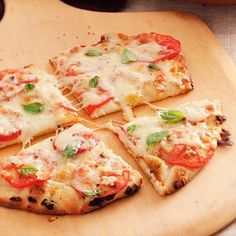 Margherita Pita Pizzas Recipe from Taste of Home -- shared by Rosemarie Weleski of Natrona Heights Pennsylvania