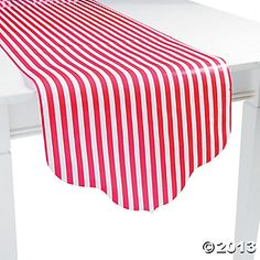 Decor: Hot pink striped table runner.  Instead of a full striped table cloth.