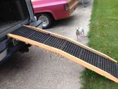Low cost dog ramp plans for easy-to-build, portable, folding wooden ramps. Low cost dog ramp plans for easy-to-build, portable, folding wooden ramps. Desig… Low cost dog r Dog Ramp For Truck, Dog Ramp For Stairs, Ramps For Trucks, Dog Steps For Bed, Pet Ramp, Dog Car Ramp, Diy Dog Kennel, Diy Dog Bed, Diy Pour Chien