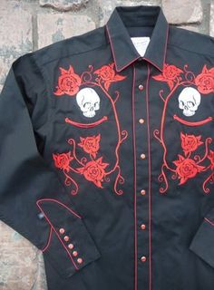 $88.00 Men's Skull & Roses Embroidered Western Shirt This 100% Cotton classic black western shirt is really well done in embroidered white skulls and fantastic red roses. Finished beautifully with contrasting red piping and snap closures.