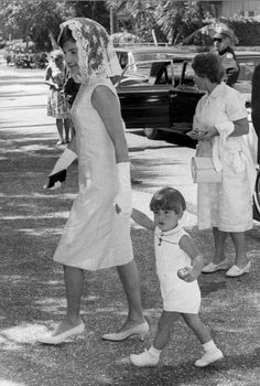 Jackie and little JFK, Jr. holding hands in Palm Beach, April, 1962