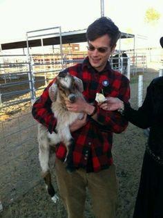 Matthew gray Gubler with a goat.
