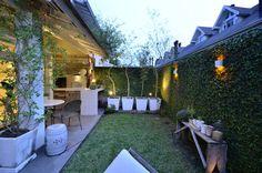 Elegante casa em condomínio : Jardins modernos por Tania Bertolucci - Arquitetos Associados