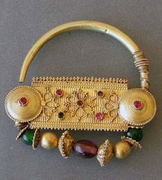 India | Nosering ~ 'nath' ~ gold and glass stones | 20th century.  Sindh, Gujarat | Price on request