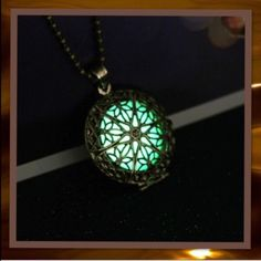 Magical fairytale necklace Round scroll design, antique gold tone solar powered glow in the dark necklace.  NEW IN PACKAGE. Jewelry Necklaces