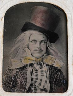 """Rare original tintype of actor dressed as """"The Mad Hatter"""".  Listing is for tintype of actor dressed in a Mad Hatter style... Handwritten inscription on matting around tintype states:  """"Ebenezer Venture before advertising for a wife"""".  My research shows that this is a book by Lawrence Labree. This was sold on eBay for 411.66 USD on January 22, 2012"""
