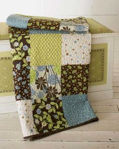 "For a throw with maximum impact made in a minimum amount of time, try this quilt made of 8-1/2"" squares. Finished Size: 56-1/2"" x 64-1/2"" This free quilt p"