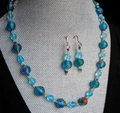 My 81 year old jewelry designer friend designed this beautiful set both earrings and necklace called TEAL APPEAL. $24.00.  So great for Summer.  :)