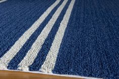 """This marine blue striped Momeni Veranda VR-15 Indoor/Outdoor area rug is hand-hooked of 100% polypropylene. It's outdoor-friendly, and great for kitchens, baths, and kids spaces too. Available in 5 colors and 5 sizes, even 9' round, you can actually hose them off! For a limited time use code """"2014Outdoors10%"""" and receive an additional 10% off all Indoor/Outdoor Area Rugs visit http://www.ruggoddess.com/momeni-veranda-vr-16-maritime-blue.html"""