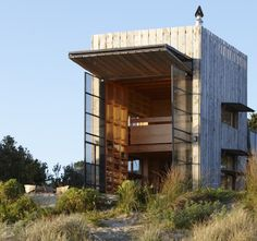 Designed by Crosson Clarke Carnachon Architects, the Sled House is built on a coastal erosion zone on New Zealand's pristine Coromandel Peninsula. Since everything on these dunes has to be removable, CCCA built the house on, well, two thick wooden sleds, making sure that the 495 square foot structure can be moved on and off the beach and even onto a barge should the occasion call for it.