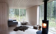 Log burner in a Finnish house: Scandinavian Retreat House Design, Home, Modern House, Forest House, House Interior, Wood Burner, Small House, Interior Design, House Blend