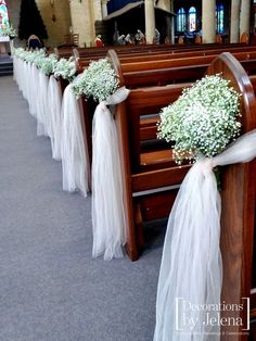 Babies breath and blush tulle wedding ceremony pew end decorations. Our Lady of Victories in New South Wales. Decorations by Jelena, Sydney Australia info@decorationsbyjelena.com.au