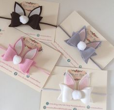 Beautiful handmade bow. Material: Made with 100% wool felt, fine glitter fabric and a white Pom Pom. Size: Measures approx 8cm wide. The bow can be attached to any of the following: A crocodile clip lined with ribbon. A thin 3mm stretch headband. A one size fits all nylon