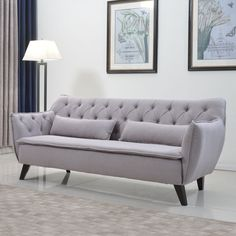 This traditional love seat design adds a contemporary look with a sleek design and solid wood legs. Style variation available.